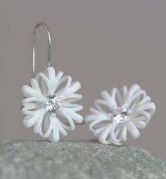 Like a drop of water the white crystal sparkles in the center of the Flower Dangle Earrings. The large but very light earrings are a statement for a wonderful day. It's a unique accessory for a wedding or an evening out.