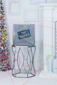 """Spy Mission: Use neon yarn to create a spy movie """"laser field"""" leading to a Spy Gear Spy Cam. Start by placing the """"top secret"""" gift near the tree.  Then string neon yarn across the room and attach to the walls to create a laser field similar to the ones in spy movies. Finally, send the kids on a Christmas morning spy mission to get their gift without tripping the lasers."""