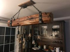 Hand hewn, reclaimed barn wood, beam light fixture, chandelier - This lamp is made from used wood, state of NY barn wood. The barn was built in It comes with - Farmhouse Lighting, Rustic Lighting, Rustic Light Fixtures, Dining Lighting, Lighting Ideas, Rustic Kitchen, Rustic Farmhouse, Western Kitchen, Log House Kitchen