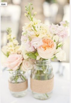 bridesmaids flowers in mason jars with ribbons
