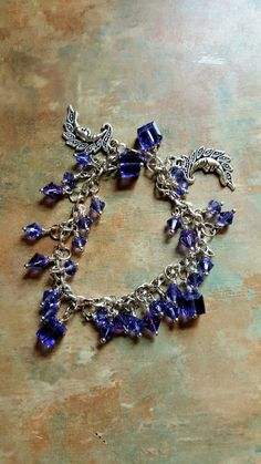 Lovely Tanzanite Swarovski Crystal Charm Bracelet With Moon Charms by WolfMountainJewelry on Etsy  22.00
