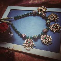 Looking for kemp jewellery designs? Check out amazing range of kemp necklace, attigai, jhumkas and lot more from this label.