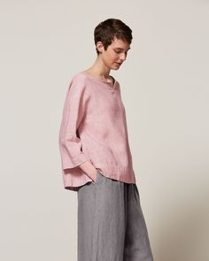 Weighty and supple garment-dyed linen. Kaftan neckline with cotton herringbone tape detail. Three-quarter length sleeves with inset panel just above cuffs. Deep, split hem - gently curving. Herringbone hanging loop at back.