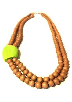 A truly stunning statement piece from the MISS MOSS range, this Mango Wood necklace features an asymmetrical lime feature bead. The neutral/smoky coloured beads that make up the rest of the design go from smaller to larger as the necklaces cascades around the wearer's neck. Buy any two items from MISS MOSS and receive a free mystery gift!