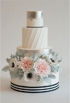 Featured Cake: Heartsweet Cakes; Gorgeous nautical theme white wedding cake with anemone and garden rose flowers