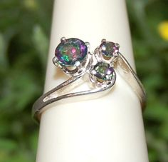 Hey, I found this really awesome Etsy listing at http://www.etsy.com/listing/153734818/graceful-3-gem-many-colors-mystic-topaz