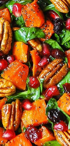 Butternut Squash Spinach Salad with Pecans, Cranberries, Pomegranate with Poppy Seed Honey-Lime Dressing. Thanksgiving, holiday gluten free salad.