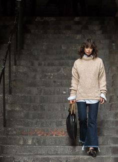 A cozy sweater is the only way to do fall. Irina Lakicevi shot by Garance Dore wears Tibi's Bubble Pullover.