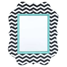 Add a chic pattern and a gorgeous pop of color to your bedroom, living room, or above your vanity with this Ornate Black, White & Turquoise Chevron Mirror! This pretty MDF mirror is ornately-shaped and features a black and white chevron background.    A turquoise border surrounds the mirror portion of the piece, and light allover distressing adds visual interest and creative flair. Stunning and fun, this mirror is a must-have for your home!        Dimensions:      Length: ...