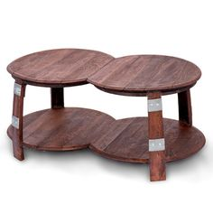 The wine barrel double round coffee table is a breath-taking conversation piece made from 4 recycled solid oak barrel end caps and 4 barrel staves.