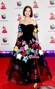 Angela Aguilar from Latin Grammy Awards Red Carpet Fashion Flower power! Pepe Aguilar's beautiful daughter will make you smile with her red carpet dress. Mexican Quinceanera Dresses, Floral Homecoming Dresses, Pretty Prom Dresses, Mexican Theme Dresses, Mexican Outfit, Mexican Fashion, African Print Fashion, Vestido Charro, Mexico Dress
