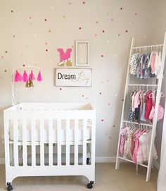 Looks like @jillian_marie_t nursery Is seeing pink in expectation for the arrival of her sweet girl! She accent her wall with our pink ombré dots and it looks amazing!!!! #ombre #dots #polkadot #polkadots #kids #nursery #nurseries #kidsdecor #mom #wallpaper #walldecals #wallstickers