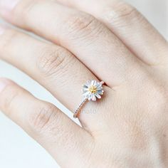 Hey, I found this really awesome Etsy listing at https://www.etsy.com/listing/192795050/tiny-silver-daisy-ring-plated-brass-925