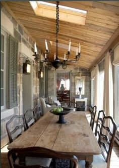 Reclaim wood dining table. Wood ceiling, skylight, chandelier, reclaimed wood dining table, big windows for light