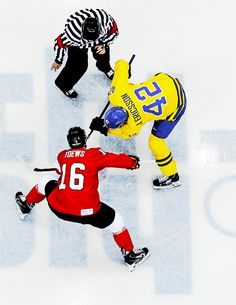 Jonathan Toews faces off with Daniel Afredsson in the gold medal game #Sochi2014 (withglowinghearts- / Tumblr)