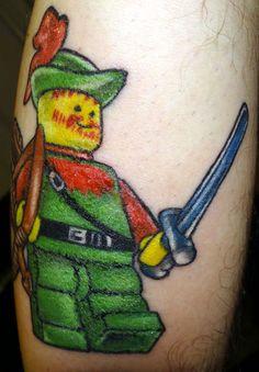 LEGO Tattoo Robin Hood #lego #legominifigure #legotattoo #tattoo #robinhood #legocastle #castle #legoforest Nerdy Tattoos, Body Art Tattoos, Cool Tattoos, Amazing Tattoos, Tatoos, Lego Tattoo, Lego Castle, Robin, Piercings