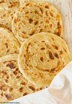 A parotta, porotta or barotta, is a layered flat bread of Kerala and some parts of Southern India, notably in Tamil Nadu made from maida flour. This is a variant of the North Indian Lacha Paratha. Parottas are usually available as street food  and in restaurants across Kerala, Tamil Nadu and parts of Karnataka. At some places it is also served at weddings, religious festivals and feasts. It is prepared by kneading maida, egg (in some recipes), oil or ghee and water. The dough is beaten into…