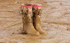 Torrential thunderstorms are predicted for Glastonbury this weekend, threatening to turn the festival site into a mud bath. Wellington Boot, Thunderstorms, Mud, Rubber Rain Boots, Peep Toe, Music Festivals, How To Make, Shots, Indoor