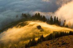 Lazar Ovidiu's photo shows fog illuminated with golden light in Rodna, Bistrita-Nasaud, Romania. See more photos from National Geographic Travel's Your Shot: Golden Hour gallery. Chateau Medieval, Visit Romania, Voyager Loin, Romania Travel, National Geographic Travel, Holiday Destinations, Belle Photo, Beautiful Landscapes, Kenya