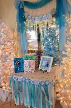 Disney's Frozen themed birthday party with Lots of Cute Ideas via Kara's Party. Love the ribbon skirt on this table