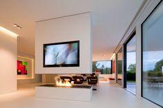 Salas de estar modernas por HI-MACS®