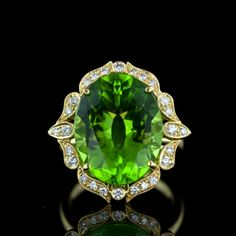 Edwardian influences. Centre Peridot 12.88ct. With 26 round diamonds 0.33 cttw. 18 karat yellow gold.