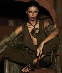 Totally Tribal look from Urban Zen's Donna Karan, worn by Adriana Lima.  Love the big, geometric necklace, olive hues/tones, etc.  As a former designer, I chose to make my own trends.  I've been given the training (FIT+Industry) & tools necessary to develop my personal style.  So, there's never any need to copy someone else. That's boring, to say the least as I find my style continues evolving! ~
