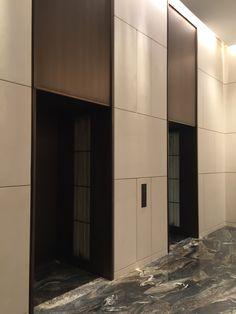 exaggerated lift head; full height effect; simple grid paneling; ivory, bronze, grey palette [Park Hyatt Hotel Hangzhou]