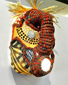 Shop our collection of beautiful textile African masks, handmade from upcycled containers and embellished with an assortment of local fabrics and other media by local artisans in Hout Bay, South Africa. Bleach Bottle, African Masks, African Jewelry, Bottle Crafts, Craft Stores, Jewelry Crafts, Upcycle, Artisan, Banana