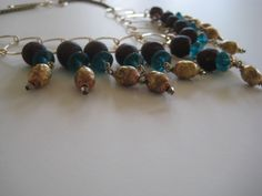Multi Indosnesian blue glass w gold male sparkle drops necklace
