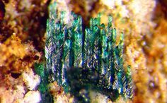 Leverettite, Torrecillas mine, Tarapacá Region, Chile. Crystals as green rhombs stacked in finger-like parallel growths, transparent and brittle in nature