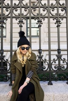 pompom beanie, cat-eye sunglasses, green coat, striped tee and black overalls #style #fashion #atlanticpacific