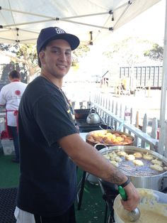 My Nephew/godson, right hand and business partner frying the banana donuts perfectly!  He's been working in the SweetStacks booth at PIFA for 10 years!