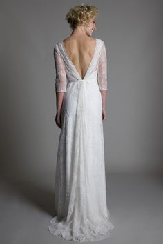 Back view of the Josephine wrap front full lace wedding dress with a low V back by Halfpenny London