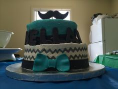 My little man's first birthday mustache bash cake.  We had some issues with the transport  due to our preference of buttercream over fondant it isn't as smooth as it could be, but it turned out ok overall