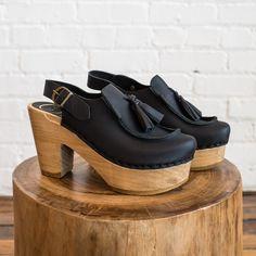 - Description - Wear & Care - Sizing A chunky platform clog in a slingback…