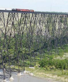 not only is it the world's longest and highest railway trestle, but the lethbridge viaduct may be the toughest too. Jamaica, Barbados, By Train, Train Tracks, Railroad Bridge, Railroad Tracks, Canadian Pacific Railway, Puerto Rico, Equador