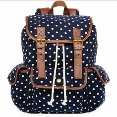 """Polka-dots Corduroy Back Pack Print cargo backpack that's perfect for school, work or whatever the course of your commute or weekend adventure. It has a top handle, 3"""" drop adjustable backpack straps (flap-style) with drawstring, and snap closure. 100% cotton with synthetic trim; polyester lining, bronze-tone metal decorative buckles, and synthetic base, 3 exterior flap pockets, and 1 zipper pocket, and 2 slip pockets inside. Colors: Dark blue, white, and brown. It has been used, but it is…"""