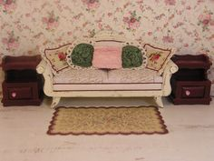 By T. Vanterpool, I repainted all three pieces, and shabby chic'd the sofa. I painted the little rose door handles on the end tables, and made the pillows. More furniture to be used in Rose Cottage.