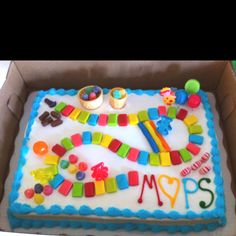 Cake made for MOPS game theme. Bought the cake at Sam's and then added the goodies. Sam wrote MOPS and I added the rest.
