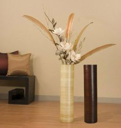 27 in. Cylinder Floor Vase, Magnolias and Pod Oars by Green Floral Crafts. Save 33 Off!. $49.99. This is an all natural, green and renewable resource product. On a scale of 1 (easy) to 5 ( for the crafty types), this arrangement is a 2.5. Floral shows best against lightly tinted wall background (flowers will not stand out against a white wall). Arrangement also includes large, cream white magnolias and whispy green grass. Unusual, large pod oars are harvested in the tropics of S...