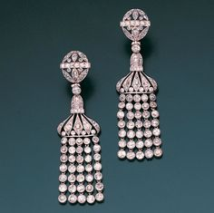 A pair of belle époque diamond pendent earrings, circa 1905  Each pierced oval surmount of millegrain-set rose and single-cut diamonds, suspending a bell-shaped drop of similarly set diamonds, terminating in an articulated fringe of individually collet mounted old brilliant-cut stones, diamonds approximately 5.20 carats total, length 6.8cm.