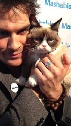 Ian Somerhalder Poses With Grumpy Cat  wow is this like a photobomb? But Ian is the photobomber? :D