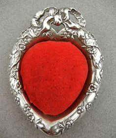 Vintage Reed & Barton Sterling Silver Heart Shaped Pin Cushion. Very pretty with the red velvet. Photo via ebay.