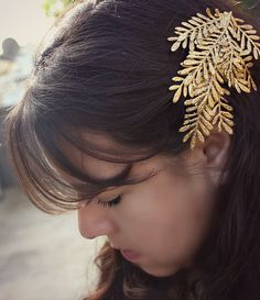 A dramatic sparkly barrette makes even a simple look party-worthy.