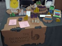 love the use of inexpensive cardboard to create signage and display stands #booth #craft stall