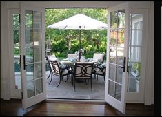 Something like this would work well from the dining area to the porch (instead of sliding glass)