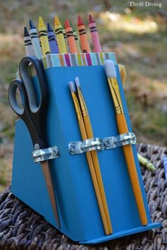Turn an Old Knife Block Into a DIY Crayon Holder!  Use to store asstd writing tools in craft room