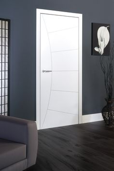 Cool and stylish white internal door with sunshine style grooved pattern. JB Kind's Limelight - Elektra #whitedoor