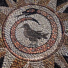 Maggy Howarth http://www.maggyhowarth.co.uk  pebble mosaic detail at the walled garden in Clifton Park, Rotherham, South Yorkshire, UK.